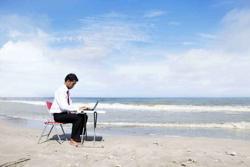 Businessman working at beach