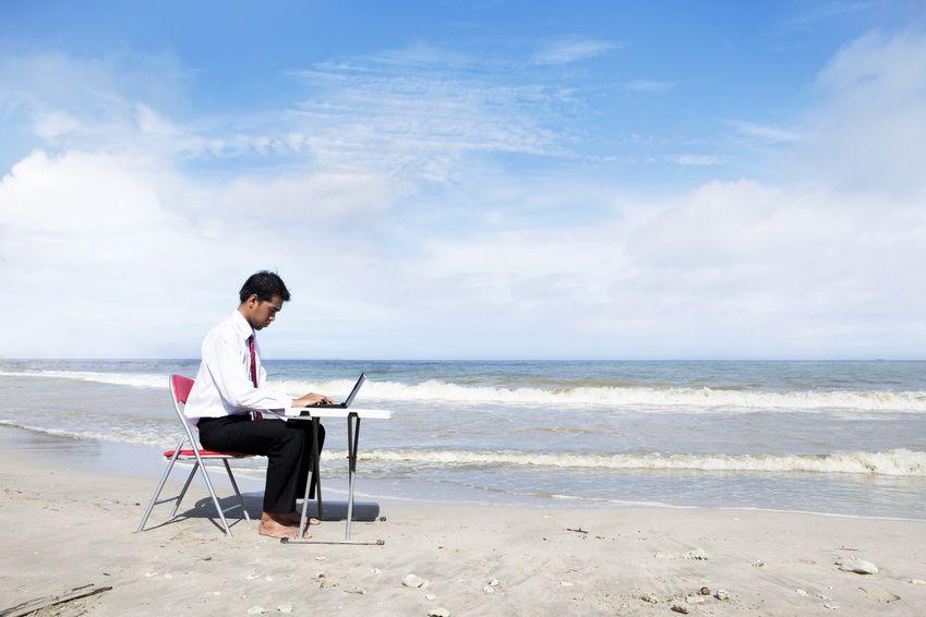 Businessman working at beach